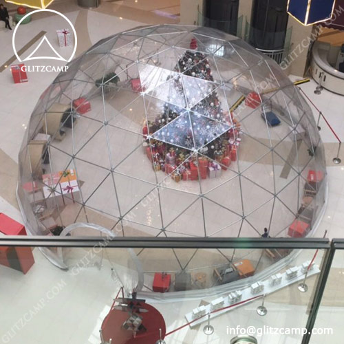 Half clear geodome tent set up at beach
